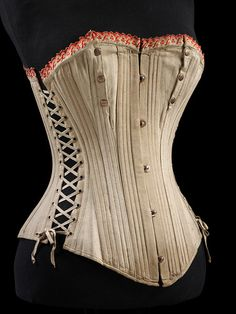 1875-1899 British or German cotton corset, the side lacing and press-stud closures at the bust suggest this is a maternity or postpartum corset