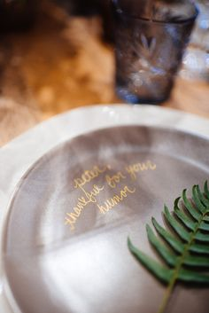 DIY - write a note to your guests on their charger! photo by Cambria Grace, styling by Lauren Wells http://ruffledblog.com/winter-bridal-shower-ideas #diy #diyprojects