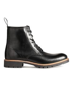 Black. PREMIUM QUALITY. Leather boots with an ankle-high leg section, lacing at front, and a loop at back. Cotton twill lining and insoles and chunky rubber