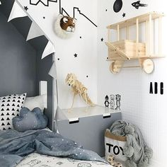 Dinosaurs, stars, and airplanes. This little boys room is full of imagination. Can you believe the airplane shelf is homemade?! Amazing space designed and photographed by @nr13b