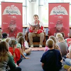 Detoit Red Wings Abdelkader, reads to elementary school children as part of MESP's Red Wings for Reading program. Saving For College, School Children, Higher Education, Elementary Schools, Get Started, Investing, Wings, Learning, Red