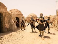 New-style armored Sandtroopers.  The new armor filters out small particles like desert sand and microbes.