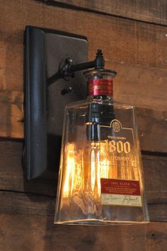 Bar/Man cave ideas: Recycled bottle lamp wall sconce 1800 Tequila by MoonshineLamp. Diy Bottle Lamp, Bottle Art, Wine Bottle Lamps, Glass Bottles, Wine Bottles, Empty Liquor Bottles, Beer Bottle Chandelier, Patron Bottles, Patron Bottle Crafts