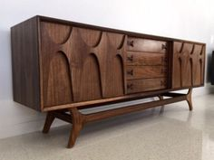 A unique mid century Brasilia inspired credenza sideboard.Hand crafted in California ,Made of solid and walnut veneer.Hand Carved Solid Walnut Arches allow you to easily slide doors.Adjustable shelfs on each side.We make holes for cables. 72 w 18 d Steel Furniture, French Furniture, Cheap Furniture, Table Furniture, Modern Furniture, Home Furniture, Furniture Design, Furniture Ideas, Danish Furniture