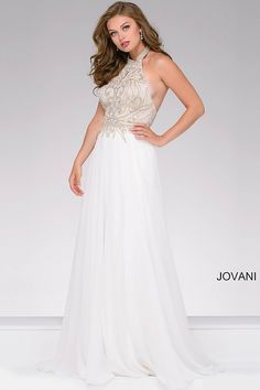Stunning ivory floor length fit and flare chiffon prom dress features beautiful beaded bodice with halter neckline and a key hole opening and an open back.
