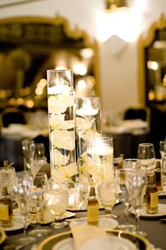 centerpieces with floating candles - flowers in white and oranges