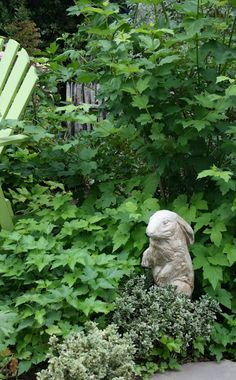 ❥ bunnies in the garden...have lots of old statuary rabbits outside-could bring one in.