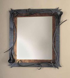 """Lily Mirror Frame""  Steel Mirror    Created by Rachel Miller  Mirror with a forged steel frame with a mica border. Hangs vertically or horizontally. Signed on reverse."