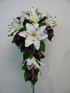 White artificial oriental lilies with dark burgundy calla lilies create this teardrop beauty