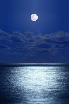 moonlit night over the ocean.
