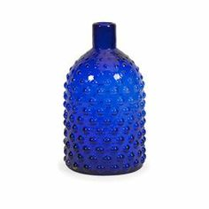 "Perfect as part of a charming vignette or for displaying an arrangement of lush blooms, this delightful jar showcases a textured geometric motif and an alluring blue finish.   Product: JarConstruction Material: GlassColor: BlueFeatures:Textured geometric motifDimensions: 16.5"" x 5.75"" Diameter"