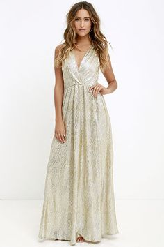 AS SEEN IN REAL SIMPLE! With its glimmering light gold fabric, the All that Shimmers is Gold Maxi Dress will have you shining like a real starlet! Sultry surplice bodice forms a deep V in front and back, while gathered fabric at the shoulders makes this sleeveless dress really shine! Elasticized waist and maxi length form a feminine shape.