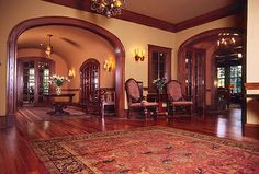 Love the arched doorways and dark wood trim!!!  So rich looking...