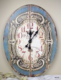 """Here's a beautiful reclaimed wood look clock.  It is a 23"""" Large Blue Oval Paris Wall Clock."""