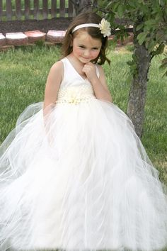 Formal tutu gown- wedding flower girl- first communion tutu dress Dress has a hand sewn satin bodice halter top. Satin ribbons are attached to the bodice and tie into a bow. Dress has a satin lining to provide a comfortable, non itchy dress to your child