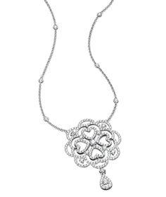 Cellini Jewelers18 karat white gold Open Work Heart Pendant.