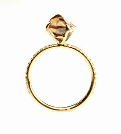 Champagne Bubbles natural uncut raw chocolate brown rough diamond ring with micro pave diamonds set in 18k pink gold. #uniquering #diamonds #luxuryjewelry