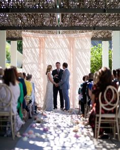Peonies, gardenias, and various flower petals were scattered along the aisle so the scent of gardenia would float through the air as Lauren approached the altar.