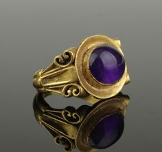 MAGNIFICENT ROMAN GOLD & AMETHYST RINGMAGNIFICENT ANCIENT ROMAN GOLD RING OF VERY LARGE PROPORTIONSHAVING DEEP CARVED DECORATED SHOULDERSWITH SCROLLS TO EITHER SIDESUPPORTING A LARGE OVAL SUNKEN BEZEL WHICH RAISES TO HOLD A LARGE AMETHYSTSOLID 22-24KTDATES: CIRCA 2ND CENTURY ADSIZE: US 11.5 & UK WWEIGHT : 27.2