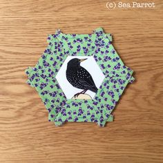 A starling in a wild pansy hexie epp quilt block. Fabrics from Sea Parrot, UK. Patchwork Fabric, Starling, Pansies, Quilt Blocks, Parrot, Fabrics, Sea, Quilts, Crafts
