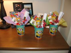 Despicable Me Minion party favor cups I put together for Brayden's birthday. Had rainbow lollipops, Minion marshmallow pops that I made, coloring pages with a rainbow crayon etc
