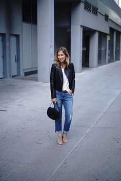 Create an effortless and chic outfit with distressed jeans and a black edgy jacket | For more style inspiration visit 40plusstyle.com