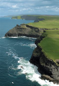 Cliffs of Moher, Ireland - The Cliffs of Moher are located at the southwestern edge of the Burren region in County Clare, Ireland. The wind-swept cliffs of Moher are a magnificent piece of natural sculpture. Oh The Places You'll Go, Places To Travel, Places To Visit, Dream Vacations, Vacation Spots, Dream Trips, Cliffs Of Moher, Ireland Travel, Belle Photo
