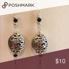 Large silver and black dangle earrings These are made with 925 Sterling silver ear wires and have plastic earring stoppers. They hang 2 1/4 inches. Black facetted glass beads and antique silver beads. Handmade by me and this is my bottom price Jewelry Earrings