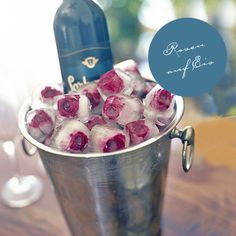 roses on the rocks...What a cool idea!  It would be cool to do this with edible flowers as well for cocktails.