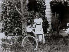"""""""Two women with bicycle,""""Hoquiam, Washington, photographer unknown, via University of Washington Libraries Commons on flickr. Modern and stylish, ca. 1900.That's an interesting device forkeepi..."""