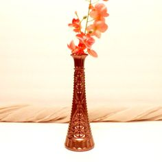 This beautiful vintage glass vase is an upcycled vase. It has been painted with a gold shimmery paint, then sprayed sporatically with a brushed bronze paint to add to its already beautiful vintage look. This vintage vase has such beautiful detailing and is sure to make a statement in any beautiful vintage home. Although this item is waterproof, I do not reccomend submerging into water or placing into the dishwasher. Its measurements are: 10 inches tall and 3 inches wide at the base. This…