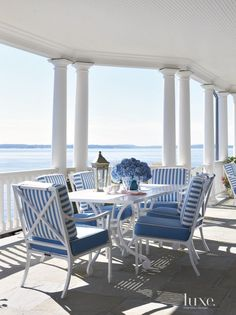 Traditional White Outdoor Dining Area with Water Views | LuxeSource | Luxe Magazine - The Luxury Home Redefined