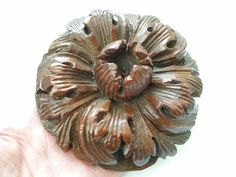Antique carved wood boss