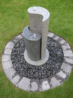 Solid granite Yin Yang water feature exclusive to Aqua . Enjoy this unique piece of craftsmanship and design.