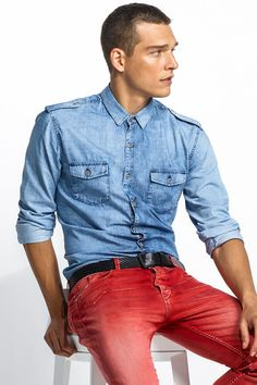 Great ensemble: denim shirt paired with red jeans!