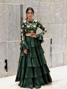 Looking for Beautiful bottle green lehenga with bell sleeved blouse and floral print along with a layered lehenga skirt? Browse of latest bridal photos, lehenga & jewelry designs, decor ideas, etc. Indian Fashion Dresses, Indian Gowns Dresses, Dress Indian Style, Indian Designer Outfits, Indian Designers, Fashion Outfits, Lehenga Designs, Indian Wedding Outfits, Indian Outfits