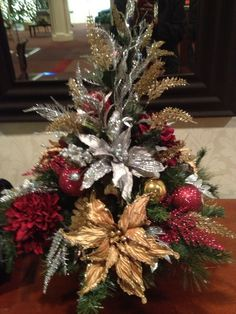 Holiday Floral Arrangement- Ideal to have various artificial floral arrangements depending on the season to display in common areas of the nursing home :) Check more at http://hrenoten.com