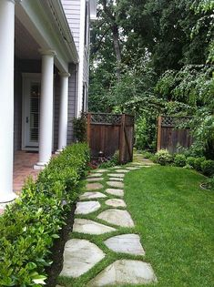 another pinner: Front garden path. Will paint the stones with Rustoleum Glow in the Dark paint and have a lit path. Should be pretty cool at Halloween. DG rocks instead of grass between the flag