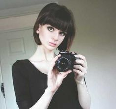 Bob Haircut with Bangs ::: Her dark hair color and blunt bob and full bangs frames her cute and petite face.