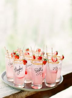 Personalized Glasses: Whatever you decide your signature drink is, like this berry-infused lemonade, serve it in a glass guests can take home. To make yours, have your calligrapher write names on each glass.