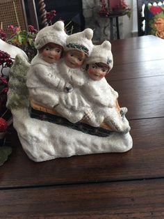 """Walnut Ridge Collectibles """"SNOWY RIDE"""" Dated 2000 and signed by the artist as shown. The group is hand painted and antiqued to look like a turn of the century Christmas group. Three adorable children are sledding down a mica covered snowy incline. 