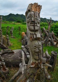 Hahoe village, Andong, Gyeongsangbuk-do - graveyard of Hahoe masks carved into the wood.