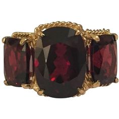 Elegant Three Stone Garnet Ring With Gold Rope Twist Border ($2,900) ❤ liked on Polyvore featuring jewelry, rings, multiple, twist ring, yellow gold rings, gold jewellery, garnet jewelry and cushion-cut rings