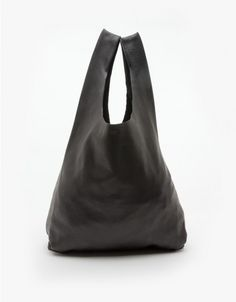 Textured leather classic tote style bag from BAGGU. Features two top handles and a simple shape made of the softest natural milled leather.  	•	Textured leather tote 	•	Casual, slouchy style 	•	Soft shape 	•	Unlined 	•	100% Leather 	•	Made in USA