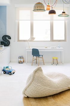 Obsessed with this gorgeous knitted pillow/beanbag and loving those lights as well. #kids #estella #decor