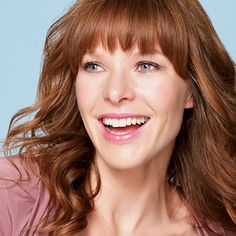 """Request brow-skimming fringe and ask your stylist to make tiny vertical snips up into the bangs to create a soft, wispy texture. """"It's more flattering than heavy blunt bangs cut straight across"""