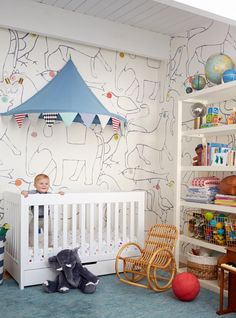 What fun wallpaper! And a circus tent over the crib! | Emily Henderson