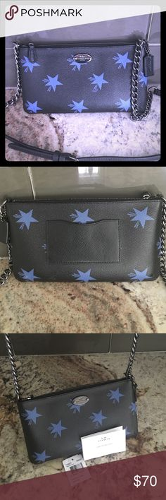 """Coach Star C Quinn Crossbody Brand new with tag removed as it was purchased as a gift. Coated canvas with leather trim. Polished nickle tone hardware. Coach logo plaque on front. Leather embossed Coach signature hangtag. Zip top closure. Back slip pocket on exterior. Interior has fabric lining, 2 credit card pockets and slip pocket. Adjustable chain link shoulder strap up to approximate 22"""" drop for shoulder and crossbody wear. Approximate measurements: 8.5"""" (L) x 4.75"""" (H) x 0.75"""" (W) Coach…"""