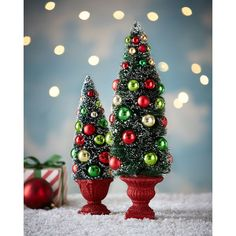 Cody Foster & Co Red/Green/Gold Miniature Trees ($50) ❤ liked on Polyvore featuring home, home decor, holiday decorations, home holiday decor, miniature bottle brush trees, gold home decor, gold pot and gold home accessories