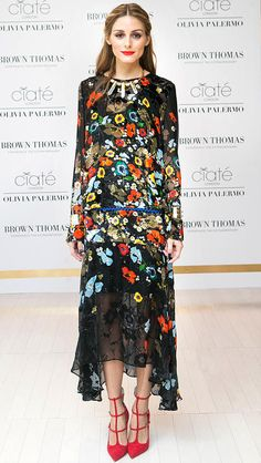 Olivia Palermo in a floral Preen dress with red strappy heels